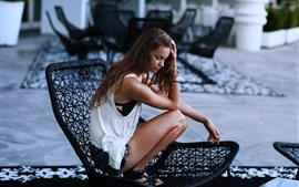 Preview wallpaper Brown hair girl, chair, pose