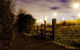 Wood fence, night, lights, trees, grass, path