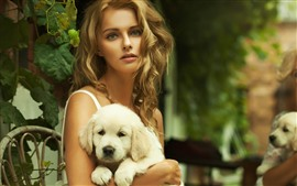 Preview wallpaper Blonde girl and white dog, chair