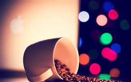 Coffee beans, cup, colorful light circles