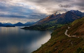 Lake, mountains, road, snow, thick clouds