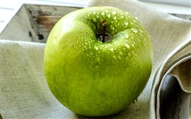One green apple, water droplets