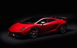 Red Lamborghini supercar, black background