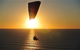 Preview wallpaper Sea, surface, parachute, sunrise, glare