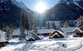 Preview wallpaper Snow, village, houses, sun rays, winter