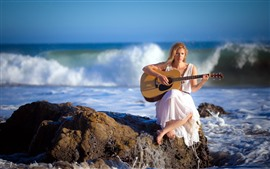 Blonde girl, guitar, sea