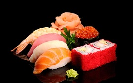 Delicious japanese food, sushi, seafood, black background