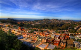 Preview wallpaper Tilt-shift photography, city, houses, hazy