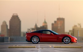 Chevrolet Corvette red supercar side view, city
