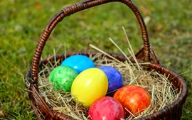 Preview wallpaper Colorful Easter eggs, basket, grass