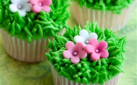 Preview wallpaper Cupcakes, green grass, flowers, creative cakes