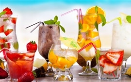 Many kinds of cocktails, strawberries, oranges, glass cups