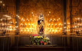 Mary statue, candles, flame