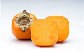 Preview wallpaper Persimmon, cutted fruit, white background