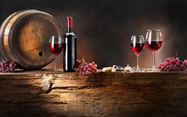 Red wine, grapes, barrel, glass cups, bottle