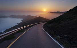 Preview wallpaper Road, sea, sunrise, fog, mountains