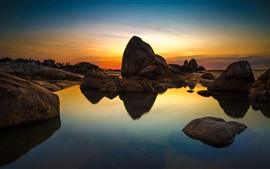 Rocks, clear water, sunset, sky