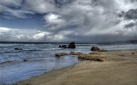 Preview wallpaper Sea, beach, rocks, clouds, storm, dusk