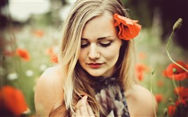 Blonde girl, red poppy flower