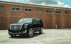 Cadillac black SUV car
