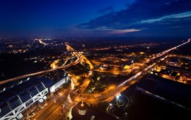 City at night, top view, roads, buildings, lights