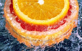 Preview wallpaper Orange slice, water
