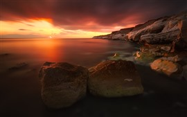 Sea, rocks, red sky, sunset, nature scenery