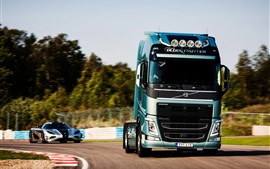 Preview wallpaper Volvo truck and Koenigsegg supercar