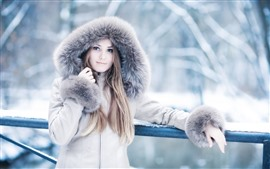 Preview wallpaper Blonde girl, coat, winter, snow