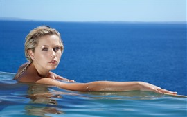 Preview wallpaper Blonde girl, hands, swimming, pool, sea