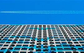 Preview wallpaper Buildings, windows, terrace, blue sky, smoke, airplane