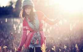 Preview wallpaper Girl, sweater, hat, plants, sunshine, glare