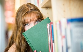 Preview wallpaper Girl, look, eyes, book, shy