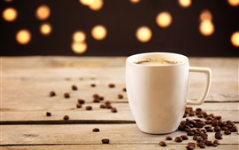 White cup, coffee, coffee beans, hazy