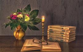 Книги, свеча, цветы, очки