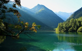 Preview wallpaper Jiuzhaigou National Park, China, lake, mountain, trees, sun rays, green
