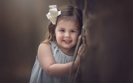 Preview wallpaper Smile little girl, child, wall, hazy