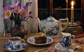 Cake, tea, cups, teapot, glasses, flowers, candle, flame
