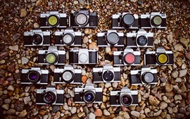壁紙のプレビュー いくつかのカメラ、石