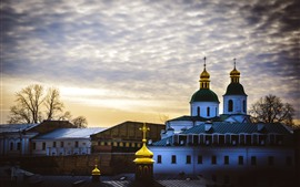 Preview wallpaper Ukraine, church, houses, clouds, sky, dusk