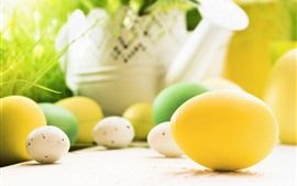Yellow, white, green Easter eggs, hazy