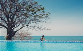 Girl, pool, tree, blue sea