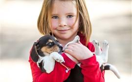 Vorschau des Hintergrundbilder Kleines Mädchen und Welpe