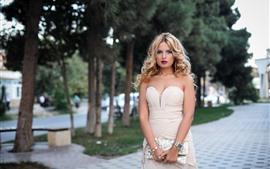 Preview wallpaper Beautiful blonde girl, hairstyle, skirt, handbag