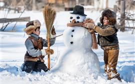 Preview wallpaper Children play snowman, winter