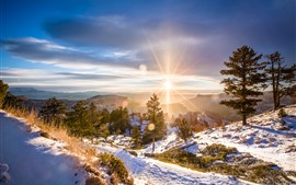 Preview wallpaper Winter, dawn, sunrise, snow, trees, mountains, sun rays