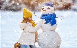 Preview wallpaper Cute little girl and snowman, winter, thick snow