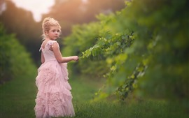Preview wallpaper Cute little girl, pink skirt, green leaves